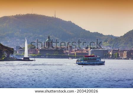 View of the city Como, a bright sunny day. Italy, the Alps, Lake Como. - stock photo