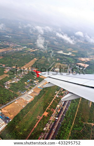 View of the city from plane window, selective focus - stock photo