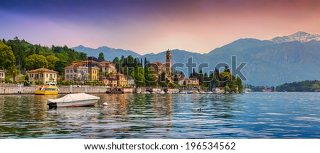 View of the city Mezzegra, Via Statale, Tremezzo CO, Alps, Italy. Colorful evening on the Como lake, Geolocation 45.982351,9.219718 - stock photo