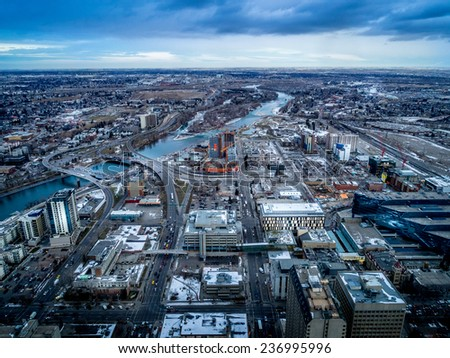 View of the city of Calgary in winter looking toward the east from a downtown skyscraper.  - stock photo