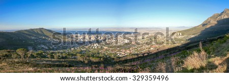 View of the city of cape town in South Africa from the Table Mountain. BVlue clear sky - stock photo