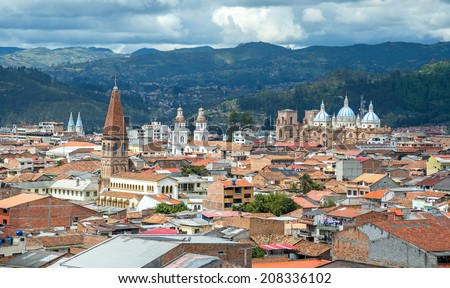 View of the city of Cuenca, Ecuador, with it's many churches, on a cloudy day - stock photo