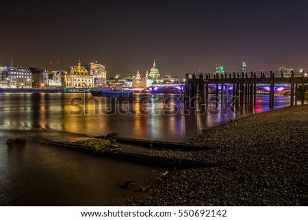 View of the City of London at night.