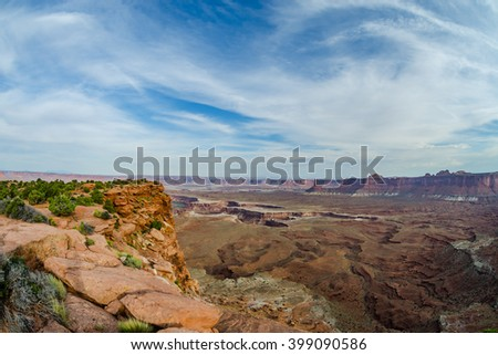 View of the Colorado River cutting through the canyon at the end of Murphy Trail in Canyonlands National Park - stock photo