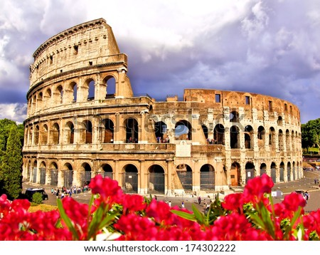 View of the Colosseum with flowers, Rome Italy                  - stock photo