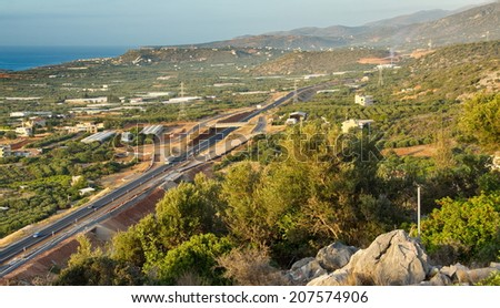 View of the Cretan New National Road at the Malia Hersonissos harbor at sunset near Heraklion, Crete, Greece - stock photo