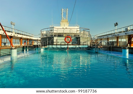 View of the cruise ship deck with luxurious pool and spa area - stock photo