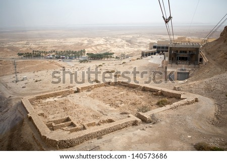 View of the Dead Sea and the cable car to the  Masada fortress, Israel - stock photo