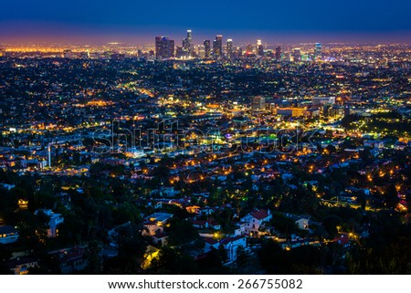 View of the downtown Los Angeles skyline at night, from Griffith Observatory, in Griffith Park, Los Angeles, California. - stock photo