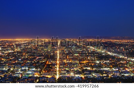 View of the downtown Los Angeles skyline at night, from Griffith Observatory, in Griffith Park, Los Angeles, California - stock photo