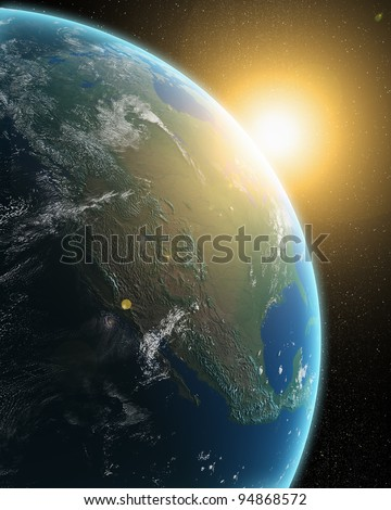 View of the Earth from outer space - sunrise over North America - stock photo