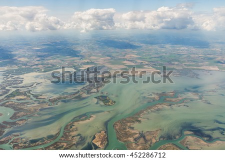 View of the earth from window of the airplane.Venetian Lagoon.