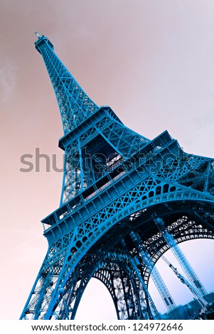 View of the Eiffel tower at sunrise, Paris. Blue toned image. - stock photo
