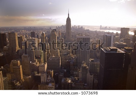 View of the Empire State Building from the Rockefeller building in new York - stock photo