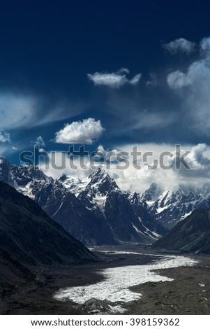View of the end of the impressive Batura glacier in the Passu region in Karakorum, Northern Pakistan - stock photo