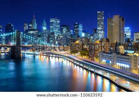 View of the financial district of Manhattan at night in New York City. - stock photo