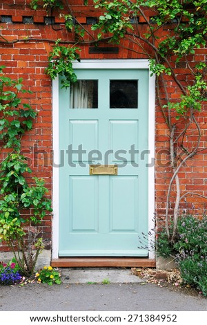 View of the Front Door of an Attractive Old Red Brick London Town House - stock photo