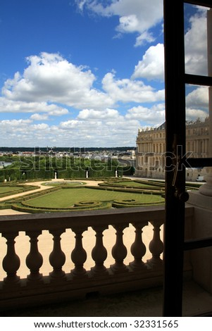 View of the gardens from interior of the Chateau de Versailles - stock photo