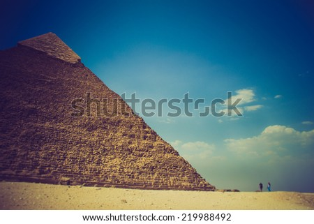 View of the Giza Pyramids, the tourists near them. Egypt. Cairo. Filtered image:cross processed effect.   - stock photo