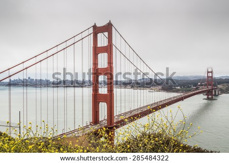 View of the Golden Gate and San Francisco bay area from the Marin Headlands. part of the bridge is covered by the marine layer fog