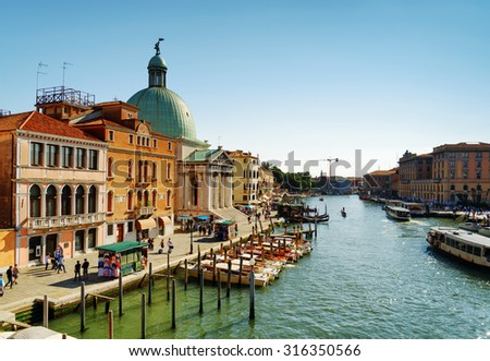 View of the Grand Canal and the San Simeone Piccolo (San Simeone e Giuda) from the Ponte degli Scalzi in Venice, Italy. Venice is a popular tourist destination of Europe. - stock photo