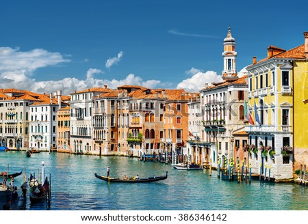 View of the Grand Canal with gondolas and colorful facades of old medieval houses from the Rialto Bridge in Venice, Italy. Venice is a popular tourist destination of Europe. - stock photo