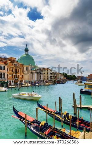 View of the Grand Canal with gondolas and the San Simeone Piccolo (San Simeone e Giuda) in Venice, Italy. Venice is a popular tourist destination of Europe. - stock photo