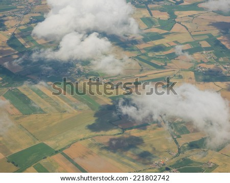 View of the ground from airplane window during flight - stock photo