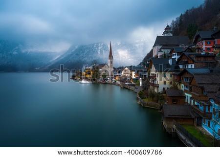 View of the Hallstatt from lake Hallstater See, Hallstatt village in Alps at dusk, Austria - stock photo