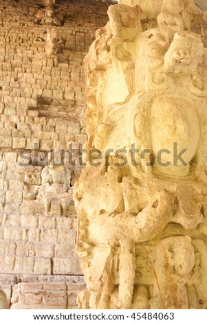 View of the Hieroglyphic Stairway, the work of King Smoke Shell and Stela M (foreground) at the ancient Mayan ruins of Copan. Honduras, Central America. - stock photo