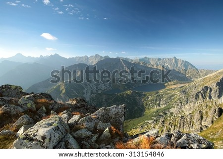 View of the high peaks of the Tatra mountains above the valley. - stock photo