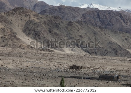 View of the Himalayas mountains and green valley from the Thikse Monastery in Ladakh, India