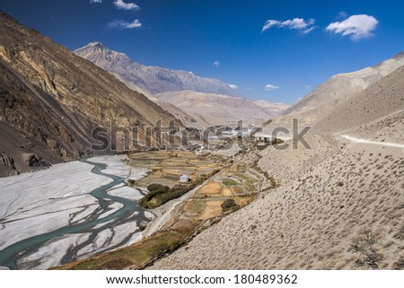 View of the Himalayas surrounded the village Kagbeni. - stock photo