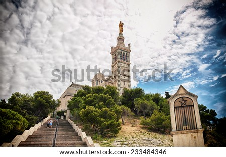 """View of the historic cathedral """"Notre Dame de la Garde"""" of Marseilles in South France. - stock photo"""