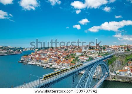 View of the historic city of Porto, Portugal with the Dom Luiz bridge. - stock photo