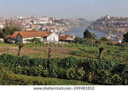 View of the historic city of Porto with the Dom Luis bridge  - stock photo