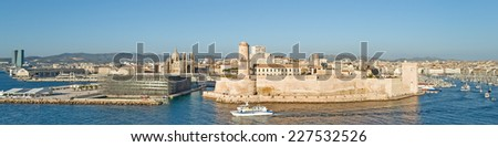 """View of the historic harbor """"Vieux Port"""" of Marseille in South France during a summer evening - stock photo"""