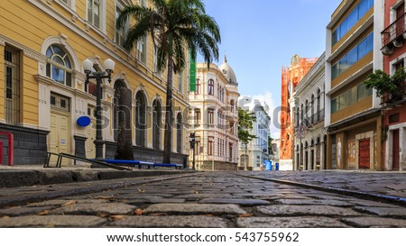 View of the historic Rua do Bom Jesus street in the city of Recife in Pernambuco, Brazil on a sunny summer day with its cobblestones and 17th century buildings.