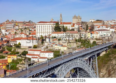 View of the iconic Dom Luis I bridge that crosses the Douro River, and the historical Ribeira and Se District in the city of Porto, Portugal. Unesco World Heritage Site.  - stock photo