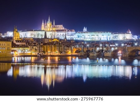 view of the illuminated prague castle and charles bridge in prague. - stock photo