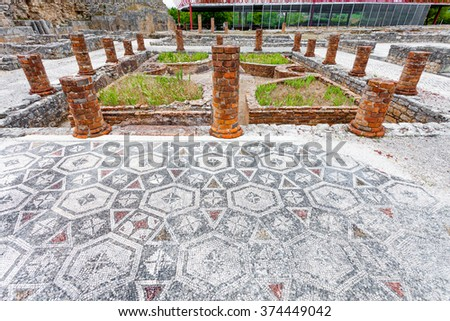 View of the inner pond and garden with the Peristyle columns and mosaic floor, on the Swastika Domus. Conimbriga in Portugal, is one of the best preserved Roman cities on the west of the empire. - stock photo