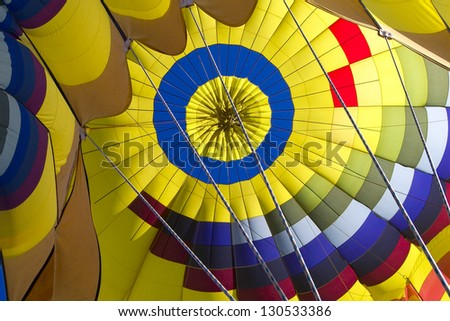 View of the interior of a colorful hot air balloon as seen from the passenger's point of view - stock photo