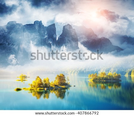 View of the islands and turquoise water at Eibsee Lake. Dramatic and picturesque scene. Location place Garmisch-Partenkirchen, Bavarian alp, Europe. Artistic picture. Creative collage. Beauty world. - stock photo