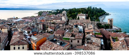 View of the Italian town of Sirmione and Lake Garda from the tower Scaliger - stock photo