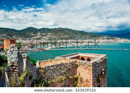View of The Kizil Kule (Red Tower) and harbor of Alanya. Turkey