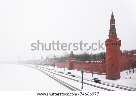 View of the Kremlin Embankment and cathedrals in Moscow, Russia at wintertime during snowfall - stock photo