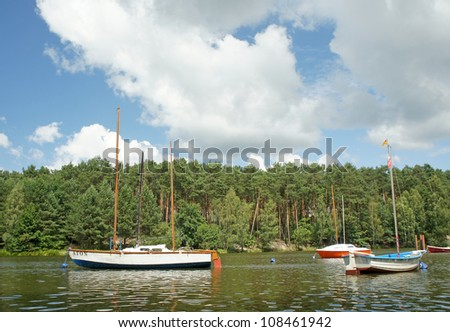 view of the lake and boats - stock photo