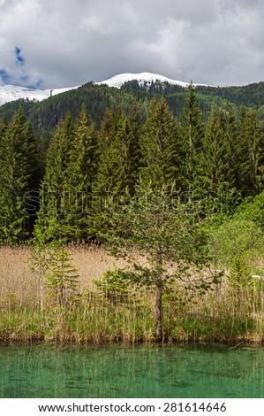 """View of the landscape at the lake """"Weissensee"""" in Austria in the springtime - stock photo"""