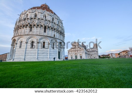 view of the leaning tower of Pisa in Tuscany in the square of miracles with the cathedral of white marble in Italy - stock photo