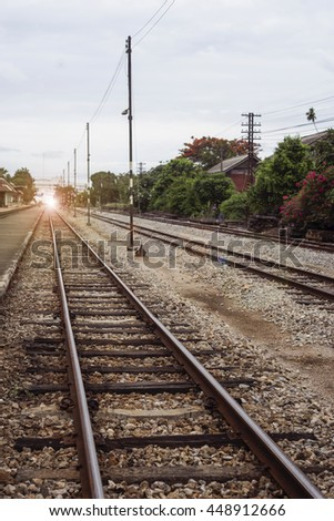 view of the length of railway ,Perspective railway,filtered image, light effect and flare added,selective focus - stock photo
